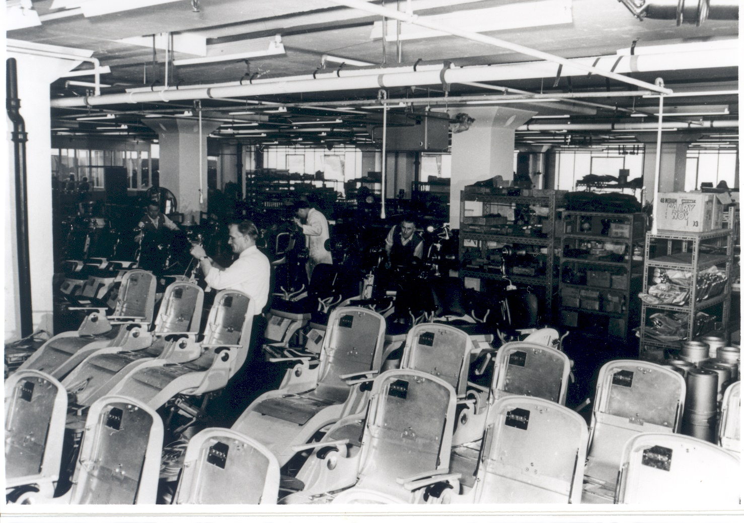 The interior of the Amalgamated Dental Factory Works, Walton, c.1967, showing two men working in part of the Dental Chair Assembly Department.
