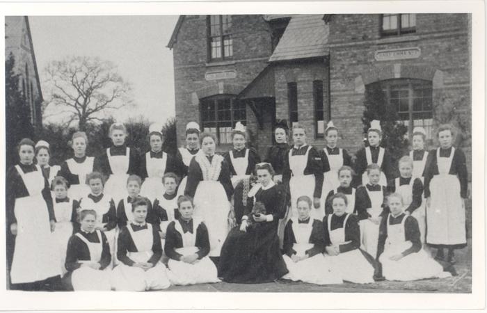Servant's outside the Princess Mary Village Homes