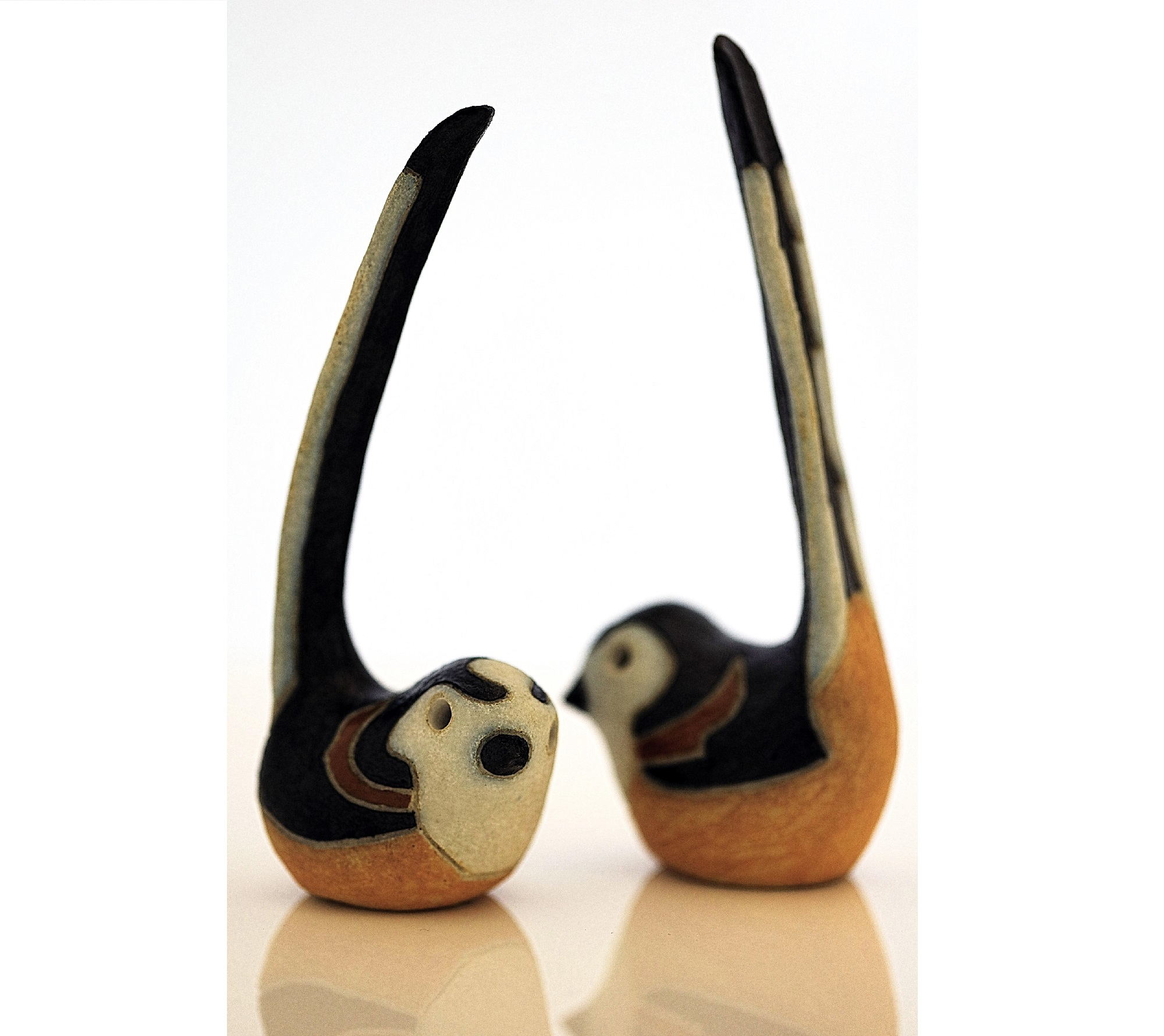 Long-tailed tits, just over life-size, with a black and white matt glaze. These were one of three pottery birds created in 1987 by Rosemary Wren and Peter Crotty from drawings from life.