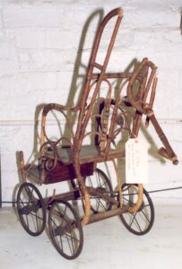 A Victorian doll's push chair, c. late 1800s.