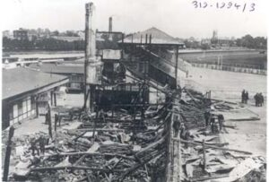 An image of the burnt grandstand at Hurst Park after Kitty Marion and Clara Giveen set fire to it in June 1913.