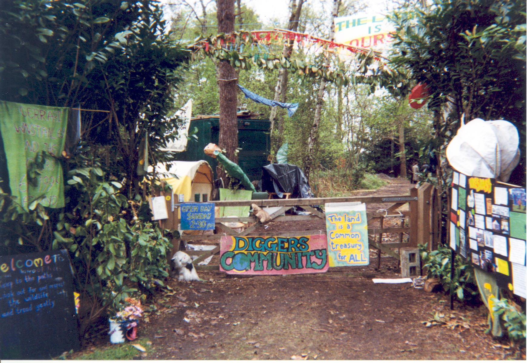 The entrance to the Land is Ours camp, April 1999. A gate with two large signs on it inscribed