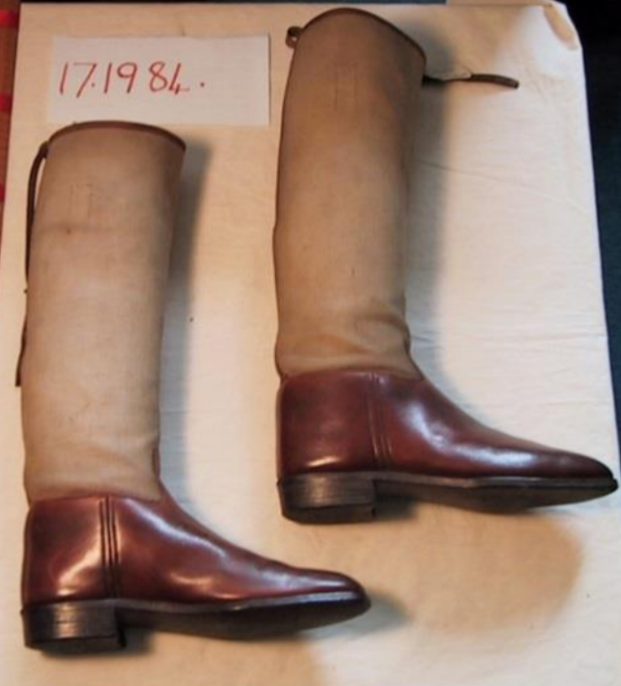 Brown leather riding boots with canvas leg covers which belonged to the vet and jockey Boyce Barrow (1847-1939).