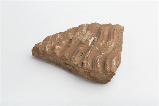Roman Tile from Chatley Farm bath house. The unique marks from the die can be clearly seen as wavey lines across the surface.