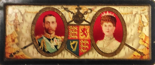 Rowntree sweet tin for the coronation fete of King George V at Crystal Palace in 1911. The lid has a picture of King George V and Queen Mary, with the Royal Standard, sceptre and orb in the middle.
