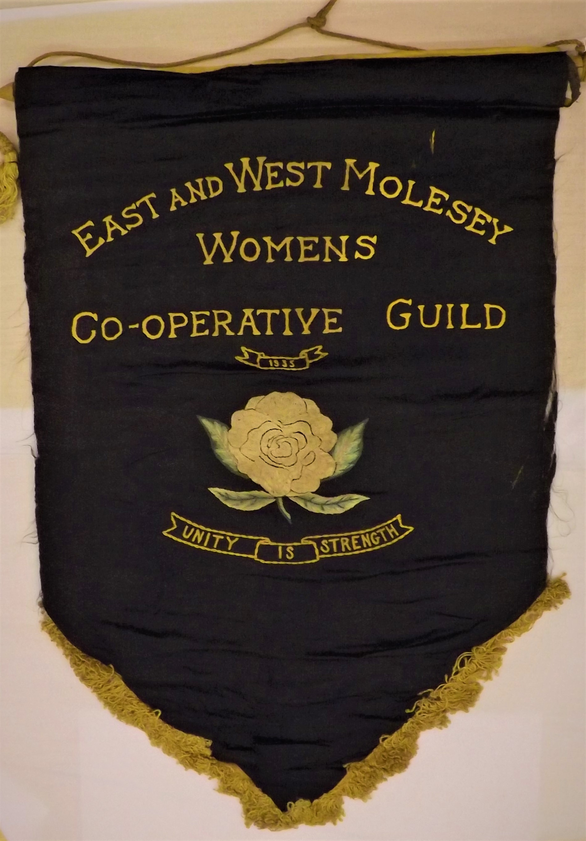Banner from the East and West Molesey Women's Cooperative Guild, an organisation descended, in part, from the Women's Freedom League.