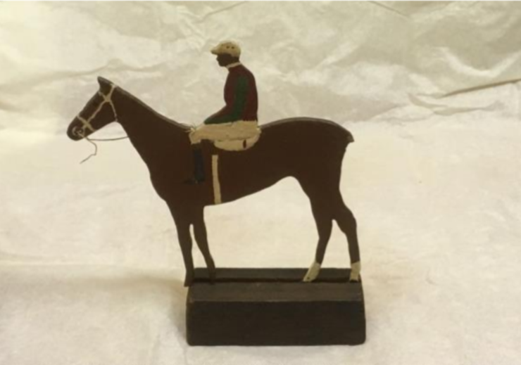 Wooden horse and jockey toy, mounted.