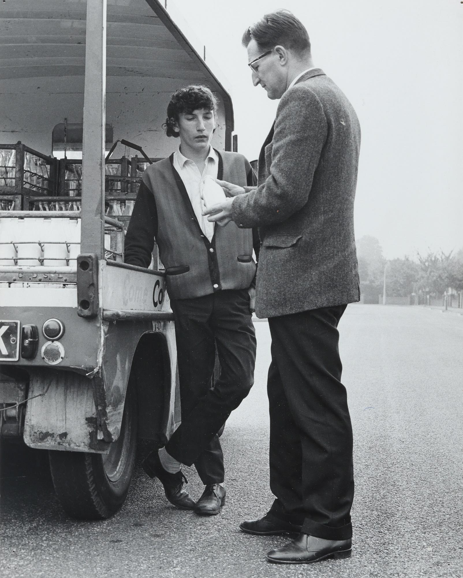 Arthur Bell checking milk on a float (c.1970s).