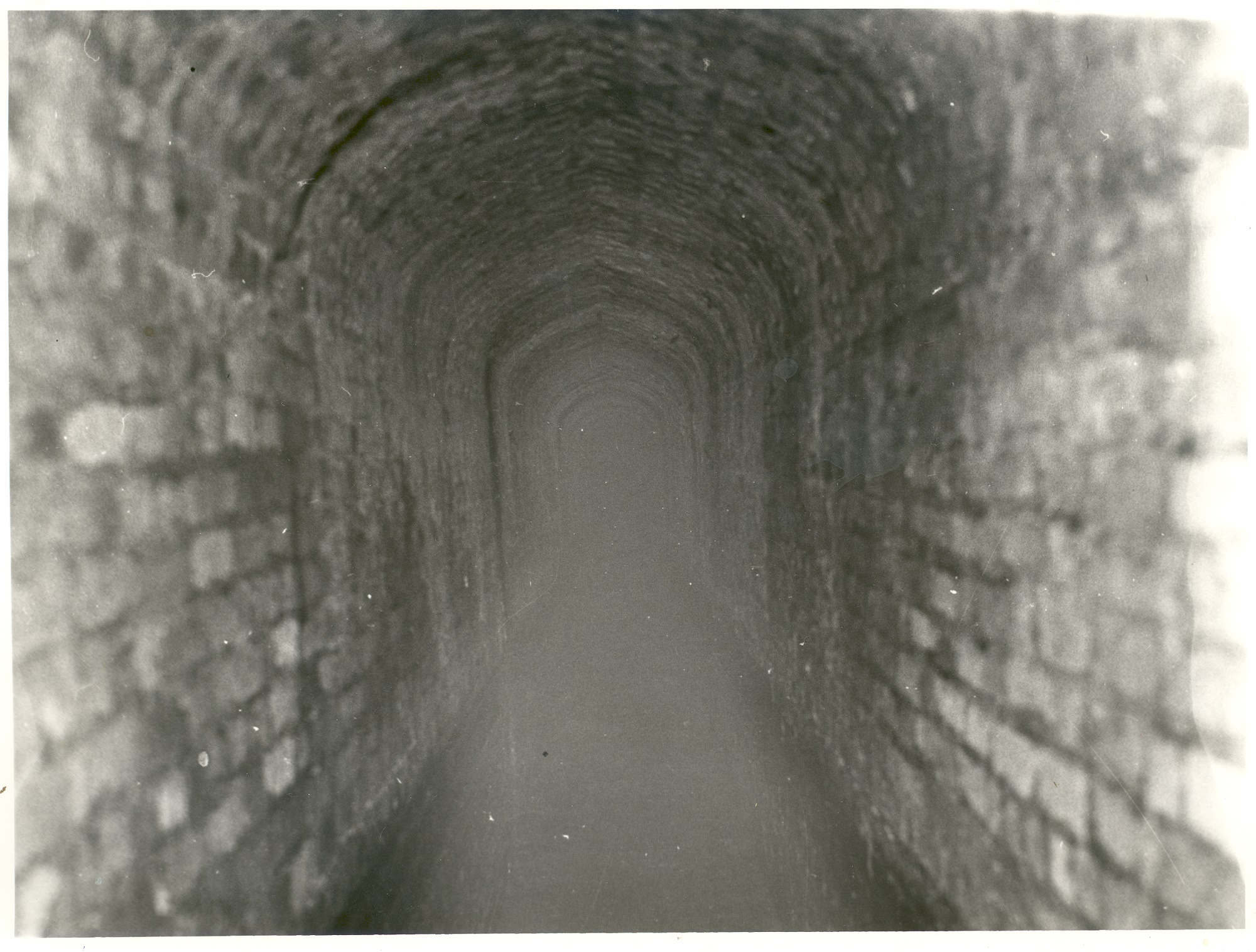 1920s black and white photograph of the interior of the Great Culvert which was inserted into the moat of Oatlands Palace.