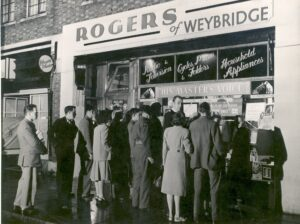 People watching early television displays at night in the shop window of Rogers & Sons, Walton High Street, c.1950s.