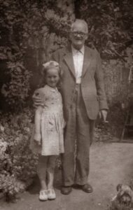 The donor with her grandfather Harry Payne in the back garden of H.G Payne's. Contributed by Sandra K.