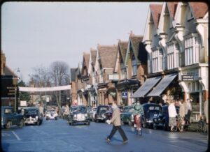 Cobham High Street, December 1956. Farrants is visible on the far right. Courtesy of I Lawton, contributed by Cobham Conservation & Heritage Trust.