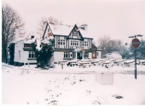 The Hare and Hounds pub, Claygate, in the snow, February 1991