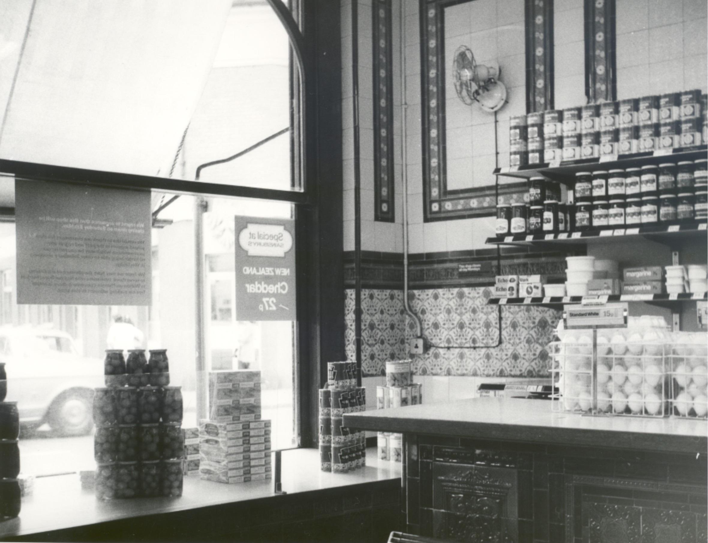 Inside Sainsbury's Weybridge, 1970. Embossed tiles can be seen on the walls.