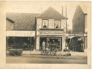 Rogers & Sons store in Weybridge High Street as an early garage & motor shop before they expanded to electrical goods, c.1920s. This is now the site of Waitrose.