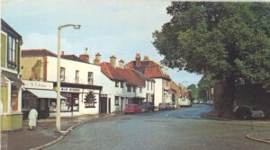Shops opposite the fountain in Thames Ditton High Street c.1960s, roughly where Bert Carr's store was situated.