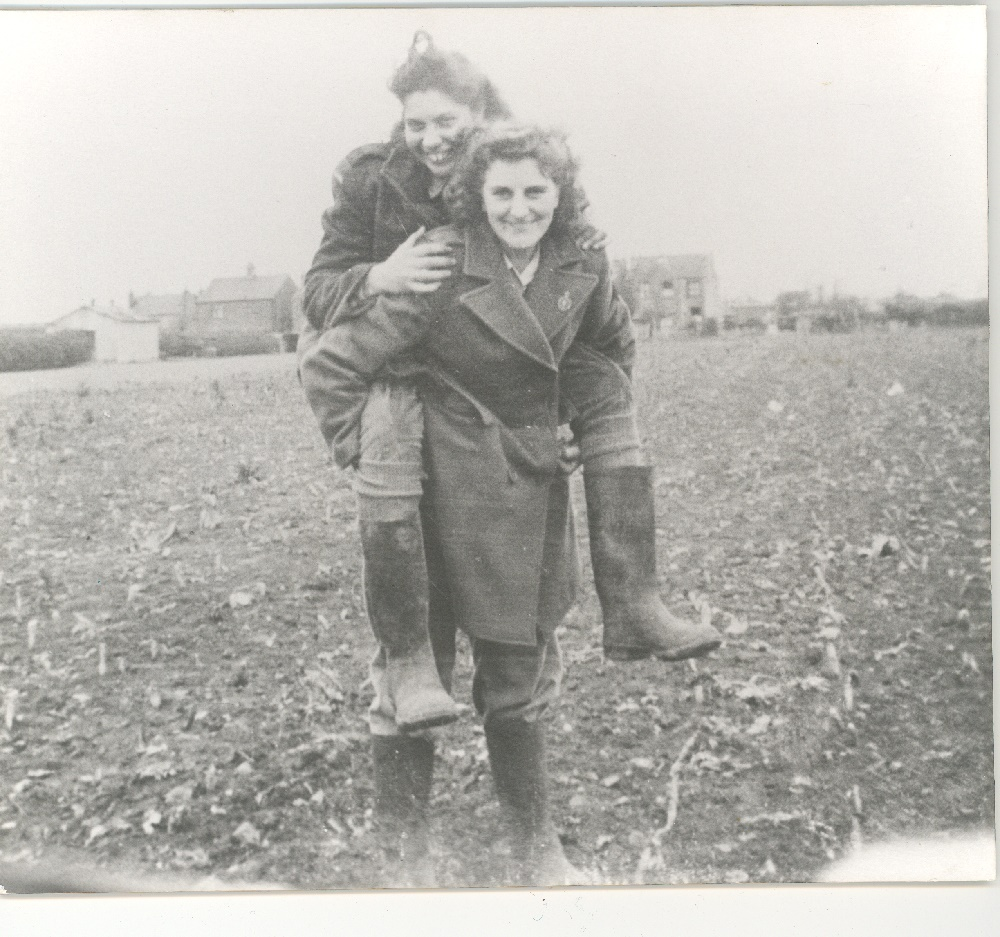 Image of two land girls who were working on Bell Farm, Hersham