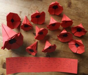 Paper poppies and interpretation by a student at Hinchley Wood Secondary School