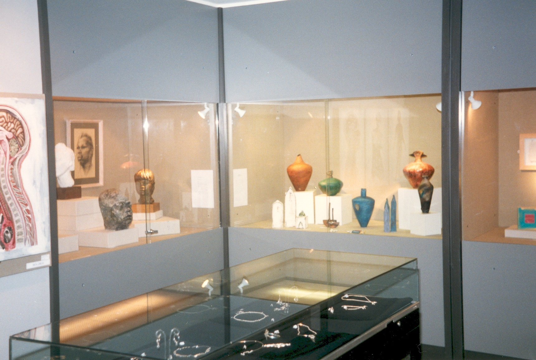 The refurbished Elmbridge Museum on 10th December 1996, showing the Temporary Exhibition with sculptures and vases in the wall cases and jewellery in the central island case.