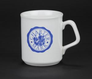 Mug with Charter Mark symbol, formerly used in Elmbridge Museum and taken into the collection in 2010.