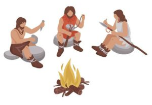 A group of stone age people sitting around a fire